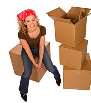 woman sitting on moving boxes
